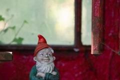 Garden gnome (Gartenzwerg) in telephone booth